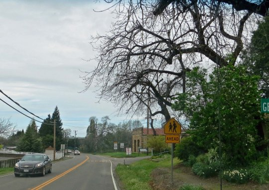 We lived on Highway 49 in Diamond Springs, California. Our house is to the right. The town's last remaining gold rush era building can be seen beyond the house.