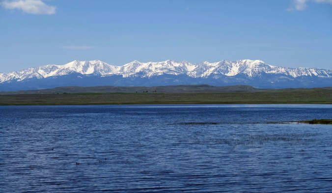Rocky Mountains behind lake in Montana.