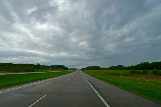 Minnesota Highway 2 leads me into North Dakota, more stormy weather, and the sneakiest dog in 10,000 miles.
