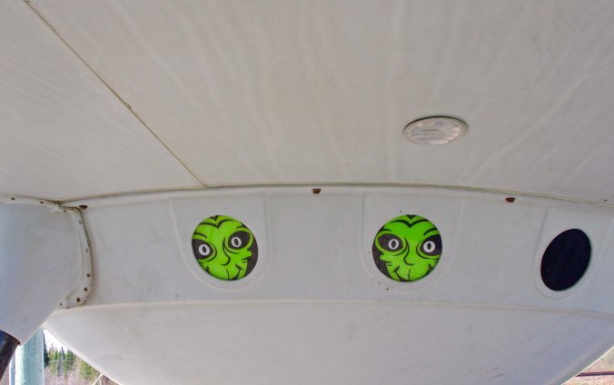 Aliens peak out window of flying saucer in front of information center in Moonbeam, Ontario Canada.