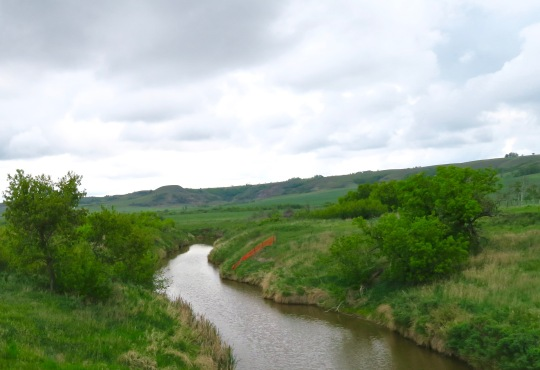A North Dakota stream in the western part of the state. Note the hills!
