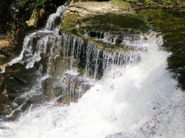America and Canada are crammed with beautiful sights that range from mountains to deserts to oceans, to plains, to rivers... and well the list just goes on and on. This is a waterfall from Old Stone Fort State Park in Tennessee.