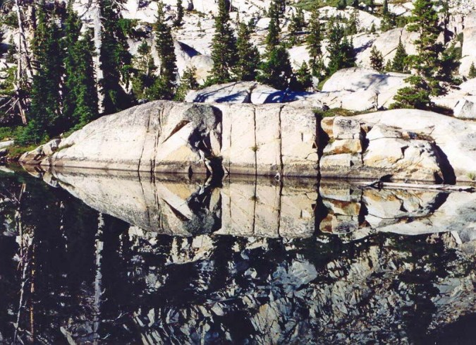 There is a series of four small lakes in the Desolation Wilderness called the 4 Q Lakes because of their shape. I took this reflection shot from my favorite camp location.
