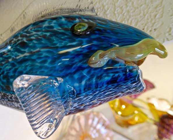 Glass fish with character at Glass Forge in Grants Pass, Oregon.