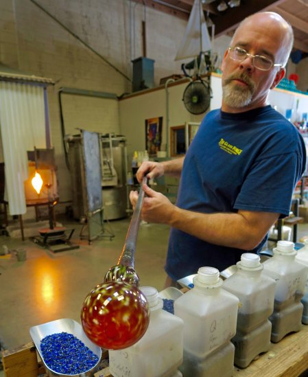 The Glass Forge of Grants Pass, Oregon was founded by Lee Wassink, shown above creating a vase.