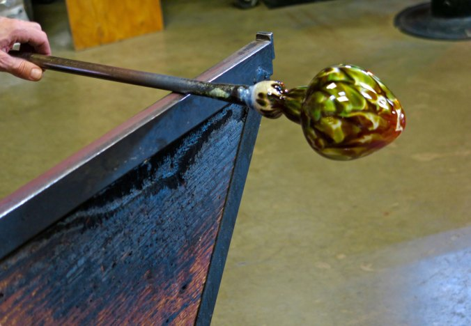 Color has been added to a vase at the Glass Forge in Grants Pass, Oregon.