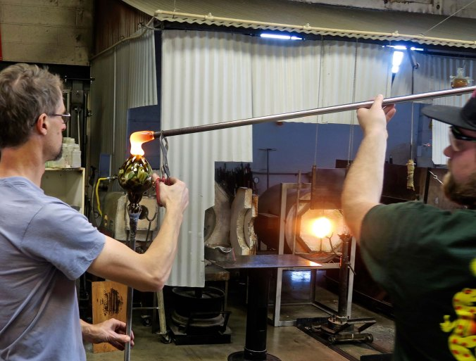 Top is added to vase at Glass Forge in Grants Pass, Oregon.