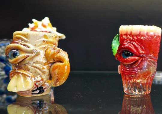 Humorous mugs created by the artists working at the Glass Forge in Grants Pass, Oregon.