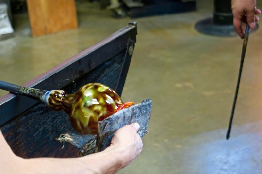 Shaping a top on a vase at the Glass Forge in Grants Pass, Oregon.