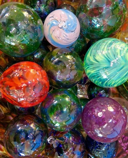Groups and individuals have an opportunity to attend a workshop and create simple glass work of their own, such as these Christmas ornament.