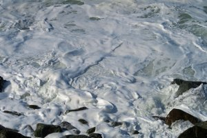 Sea foam beat into whip cream type consistency along Highway 101 on the North Coast of California.