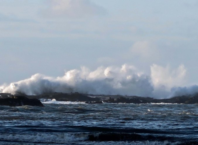 The Oregon Coast is noted for its crashing waves such as these at Sunset Bay near Coos bay, Oregon.