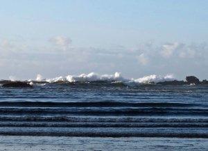 Waves crashing over rocks outside of Sunset Bay near Coos Bay, Oregon.