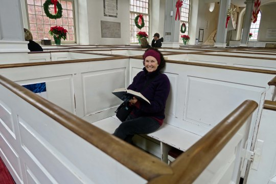 Peggy sits in one of the pews holding a hymnal. Today, the pews are based on first come-first serve. But in 1775, the pews were 'owned' by their occupants and passed down through families. One of the guides told us that the cost for one the pews was the equivalent of what a middle class family might earn in a year today. Not cheap.