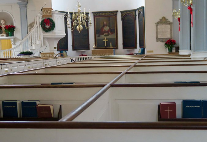 Looking across box pews toward the altar at the Old North Church in Boston.