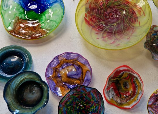 Variety of bowls displayed at the Glass Forge in Grant's Pass, Oregon.
