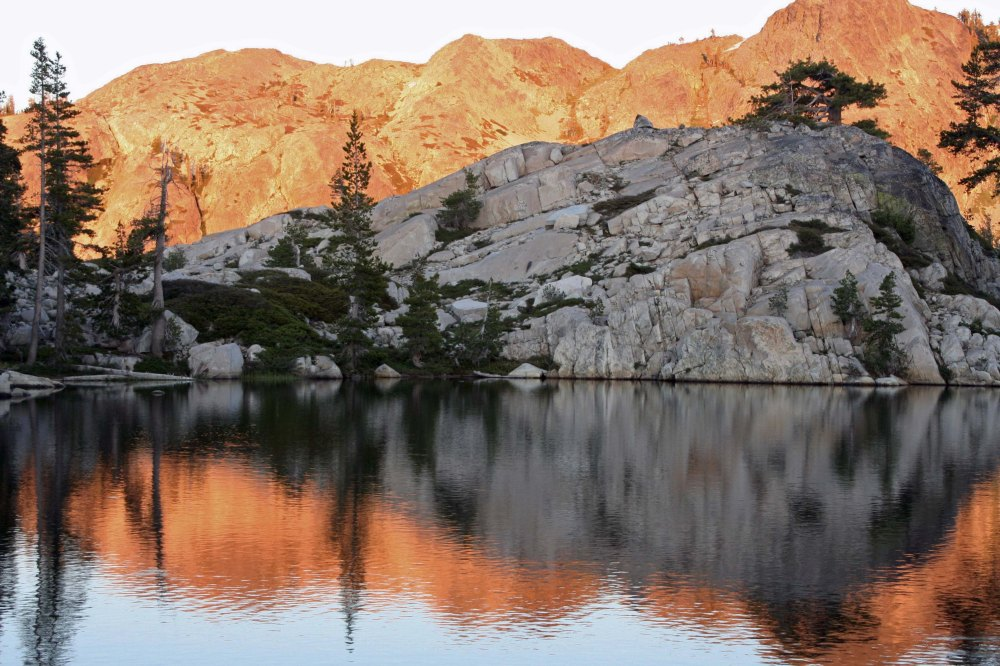 The Black Buttes of the Sierra Nevada Mountains are lit up by the evening sun.