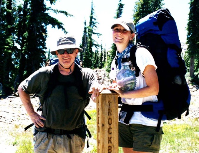 Speaking of family, this is our daughter Tasha standing with me in the Desolation Wilderness next to a trail sign. She went on several treks with us.