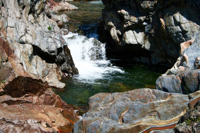 Waterfall and pool on Five Lakes Creek in the Granite Chief Wilderness area behind Squaw Valley, California.