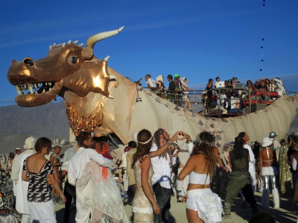 Early in the morning before sunrise, Abraxas likes to hang out at the Temple, you can see him lurking out on the Playa. When the sun comes up, it is time to dance and he fires up his 10,000 watt speakers as Burners gather around.