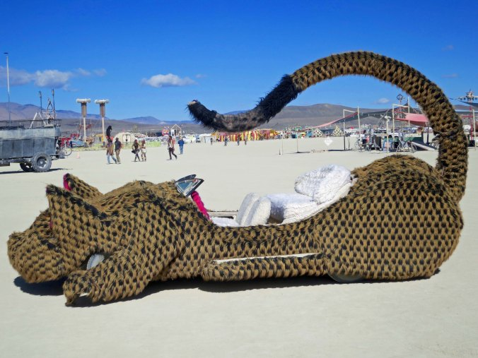A side view of the cat car mutant vehicle at Burning Man.