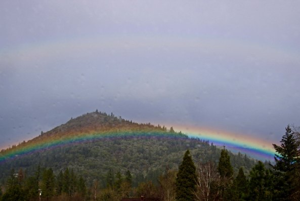 I'll conclude with this hill hugging rainbow we found welcoming us back to the Applegate Valley. (Photo by Peggy Mekemson.)