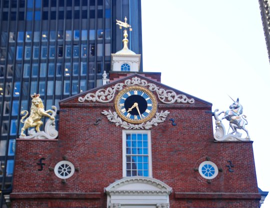Boston's Old State House sits just across the road from Faneuil Hall. The Boston Massacre took place between the tow buildings. Check out the weather vane... (Photo by Peggy Mekemson.)