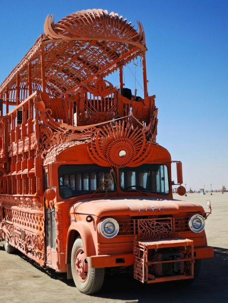 Orange bus mutant vehicle at Burning Man.