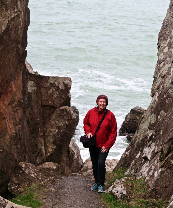 Peggy Mekemson hiking down trail at Harris beach State Park near Brookings, Oregon.