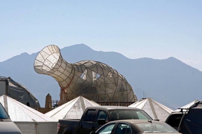 Vase mutant vehicle at Burning Man with mountain backdrop.