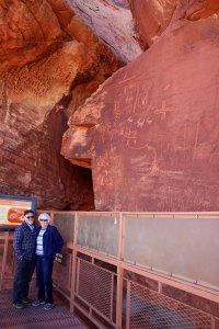 Ken and Leslie Lake provide perspective on viewing platform on Atlatl Rock in Valley of Fire State Park.
