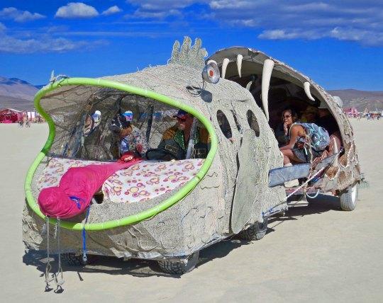 Fish eating fish with provocative tongue mutant vehicle at Burning Man.