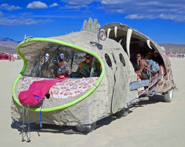 Fish eating fish with provocative tongue mutant vehicle at Burning Man.