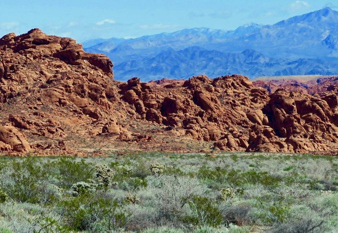 Red sandstone rocks and mountains at Valley of Fire State Park in Southern Nevada.
