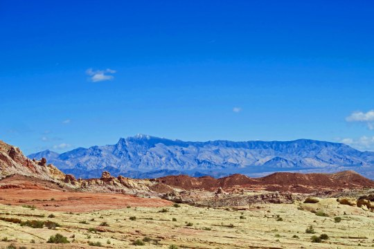 Rainbow Vista at Valley of Fire State Park in Nevada with mountains providing contrast.