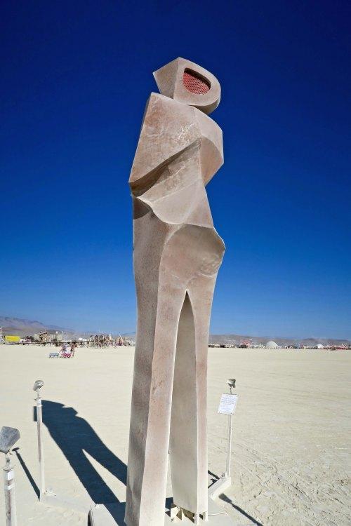 Man looking over shoulder sculpture at Burning Man 2017