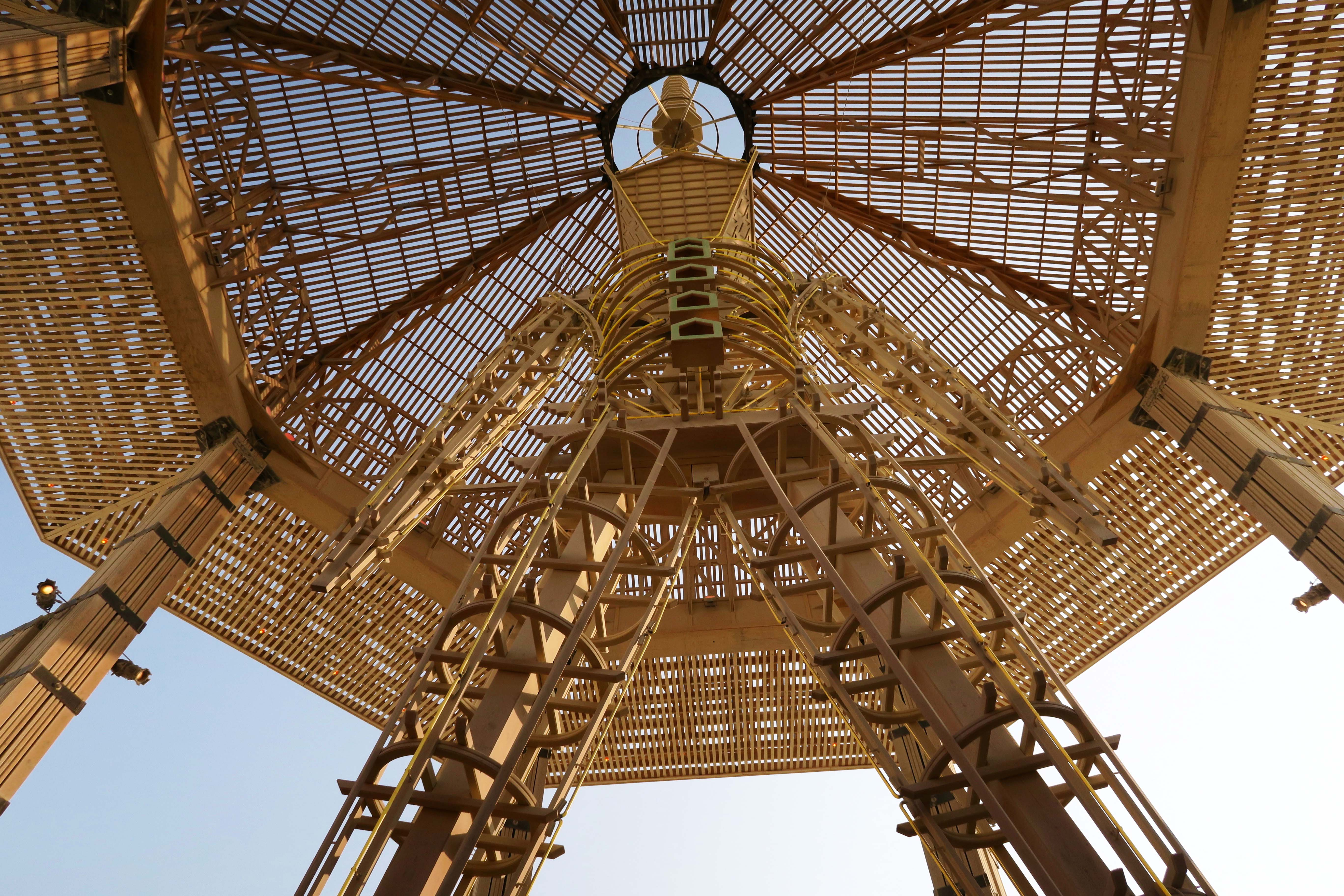 Looking up at Man in Temple of the Golden Spike, Burning Man 2017