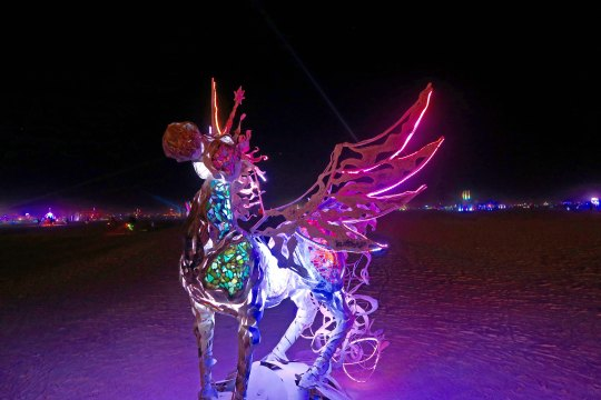 Nighttime flying horse at Burning Man 2017