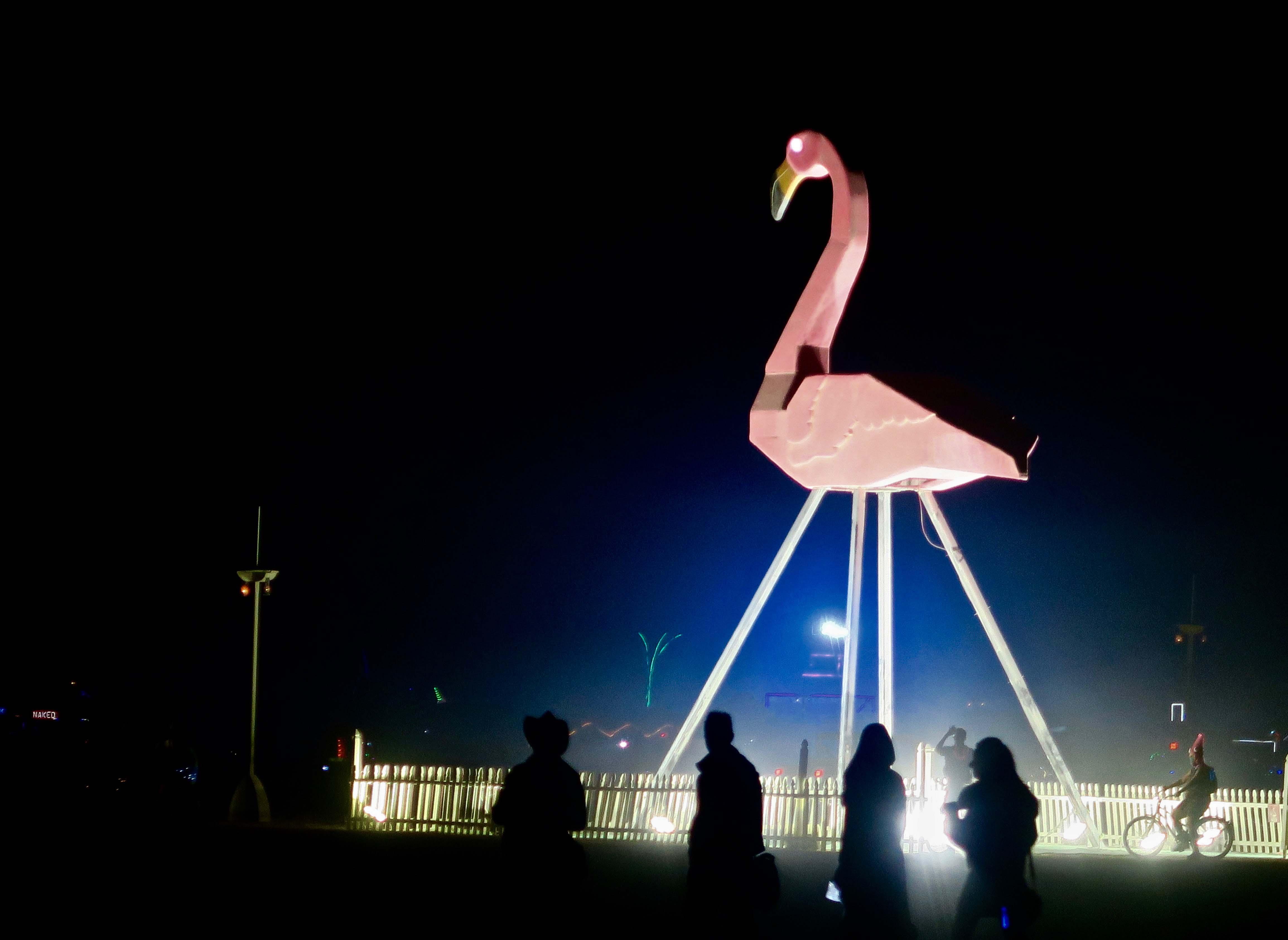 Nighttime giant flamingo at Burning Man 2017