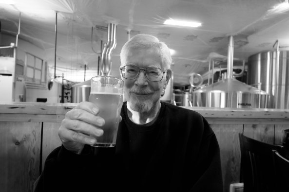 Curt Mekemson enjoying a pint at Pelican Brewing Company in Tillamook, Oregon.