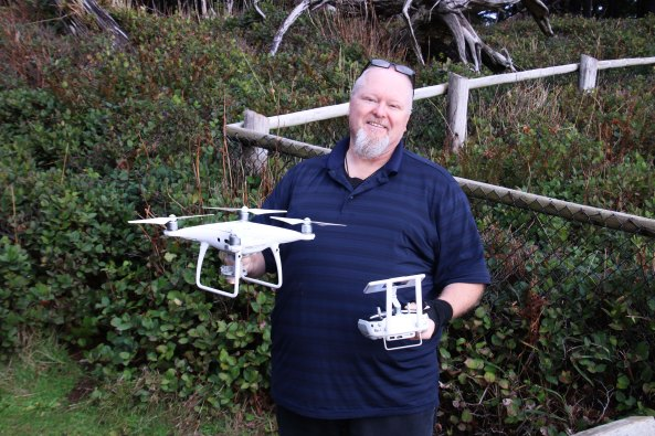 Man with drone at Cape Meares.