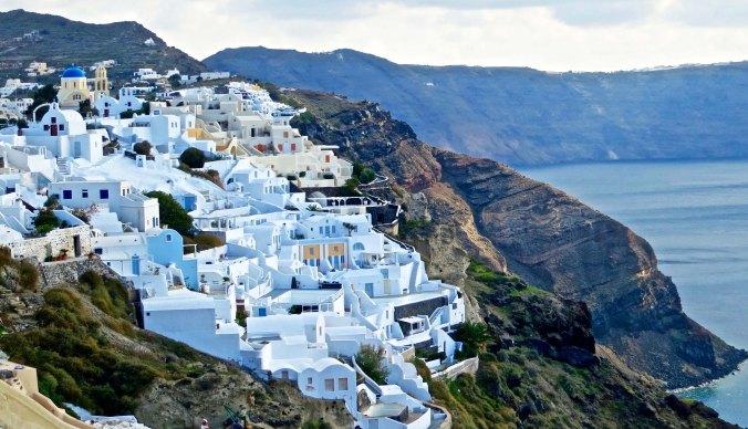 Photo of buildings on cliff in Santorini by Curtis Mekemson.