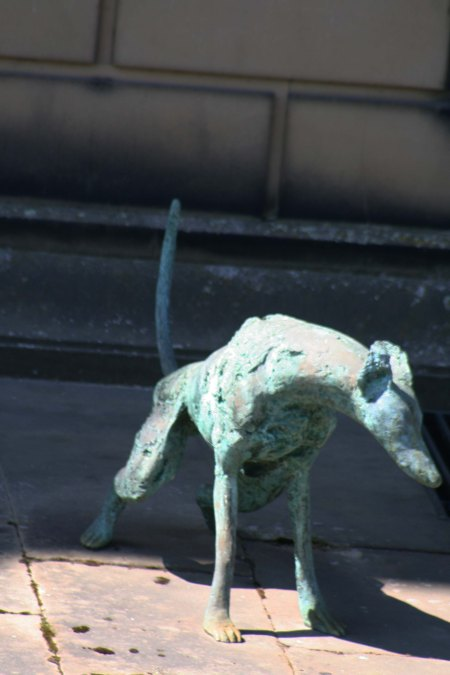 Dog sculpture peeing at Chatsworth House