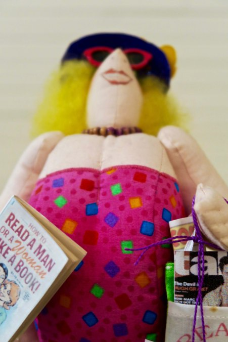 Doll at quilt shop