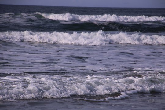 Gentle waves roll in at Rockaway Beach, Or P