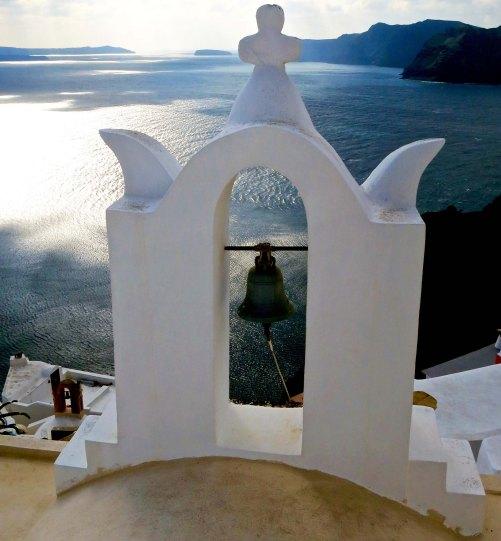 Bell on chapel looking out toward Aegean Sea on Island of Santorini. Photo by Curtis Mekemson.