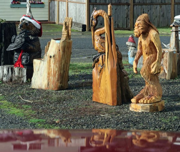 Sasquatch hangs out with carved heron