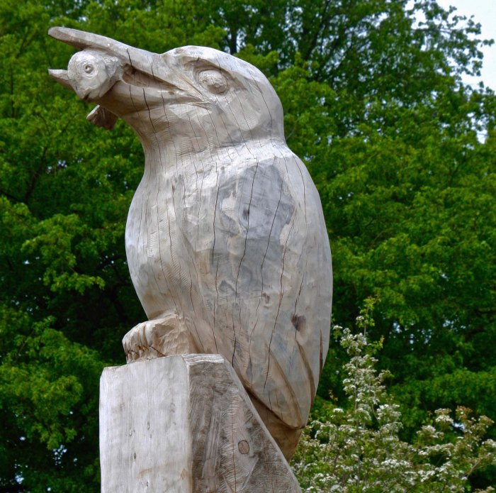Carved kingfisher sculpture with fish in Burton upon Trent
