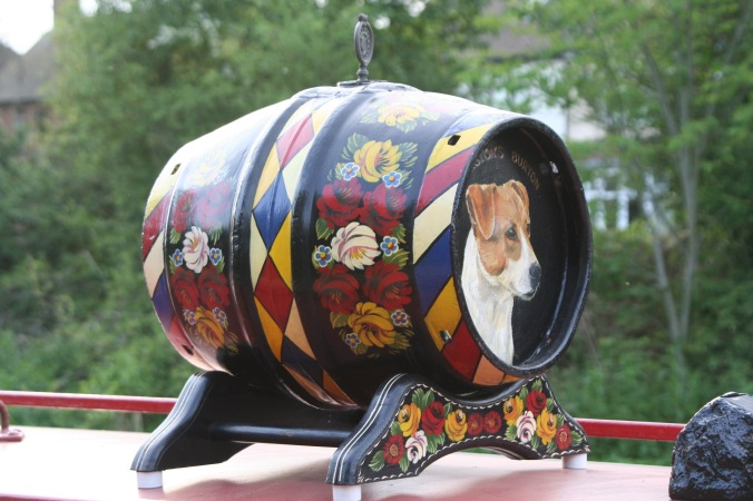 Narrow boat dog on barrel on Trent and Mercy Canal