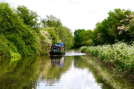 Narrowboat with rain cover on Trent and Mersey Canal